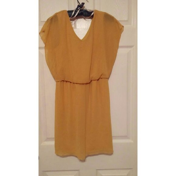 A mustard yellow dress It's a size M  The color is a mustard yellow  It's a lightweight material  I worn it a couple of times but still in condition ! Dresses Mini