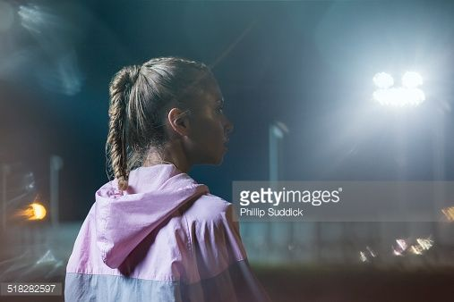 Stock Photo : Portrait of a female urban runner at night