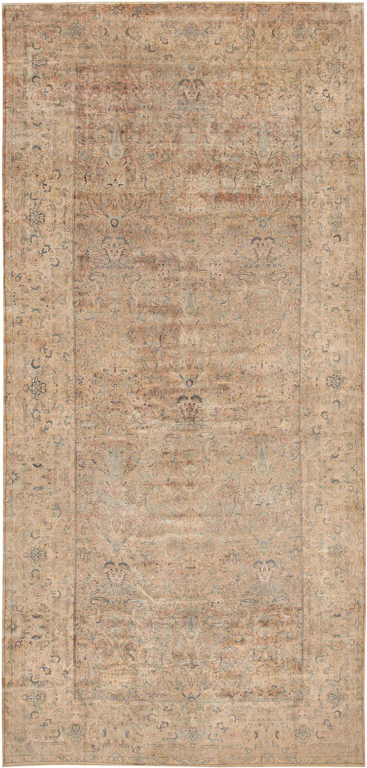 Antique Persian Kerman rug, Country of Origin / Rug Type: Persian Rugs, Circa Date: Early 20th century 12 ft 5 in x 25 ft 9 in (3.78 m x 7.85 m)