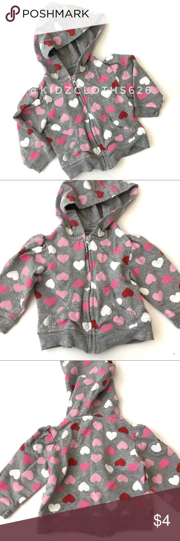🍭 Valentines Zip up 🍭 Valentine's Zip up in grey with pink white and red hearts. Hooded with 2 front pockets. In Play Condition with some fading and wash wear and a small on sleeve (see pictures) 🍭Consignment Item, Smoke/Pet free home 🍭 ❗️Must be bundled❗️ Shirts & Tops Sweatshirts & Hoodies