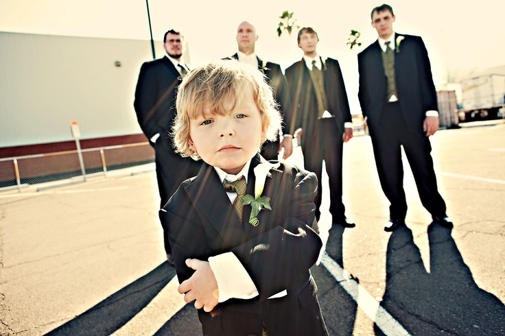 Photo of the groomsmen and the ring bearer.