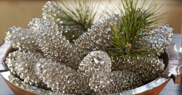 Spray paint pine cones to have that mercury glass look to them. Use Krylon Looking Glass Mirror-Like Paint on pinecones, add a little fresh or faux greenery to accomplish this look.*** 10/10** this link really doesn't tell you how to do this, but it's pre