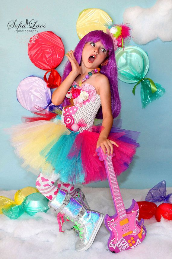 Katy Perry inspired coordinating top hat *** Hat comes on 2 clips *** Headband is optional please message me if you want it on a headband For the dress pleasew follow this link https://www.etsy.com/listing/125831889/katy-perry-inspired-candy-land-tutu?ref=shop_home_feat