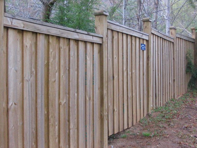 Stepped wood fence with finials