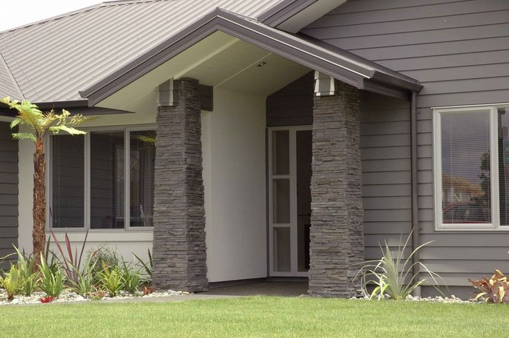 Nice exterior, weatherboards and stone pillars