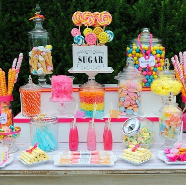 Colorful Wedding Dessert Table With Vibrant Treats And Whimsical Sweets