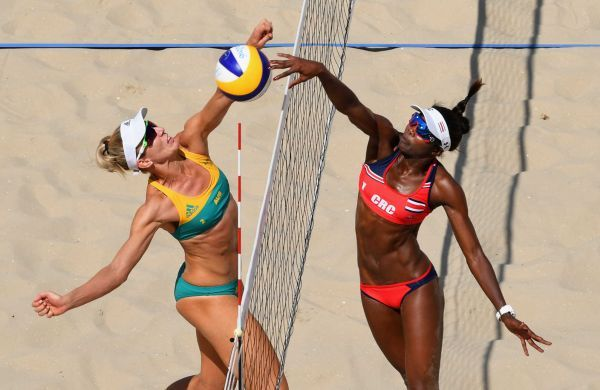 Louise Bawden and Karen Cope Charles of Costa Rica jump at the net during the Women's Beach Volleyball preliminary round Pool F match between Australia and Costa Rica on Day 1 of the Rio 2016 Olympic Games at the Beach Volleyball Arena on August 6, 2016 in Rio de Janeiro, Brazil.