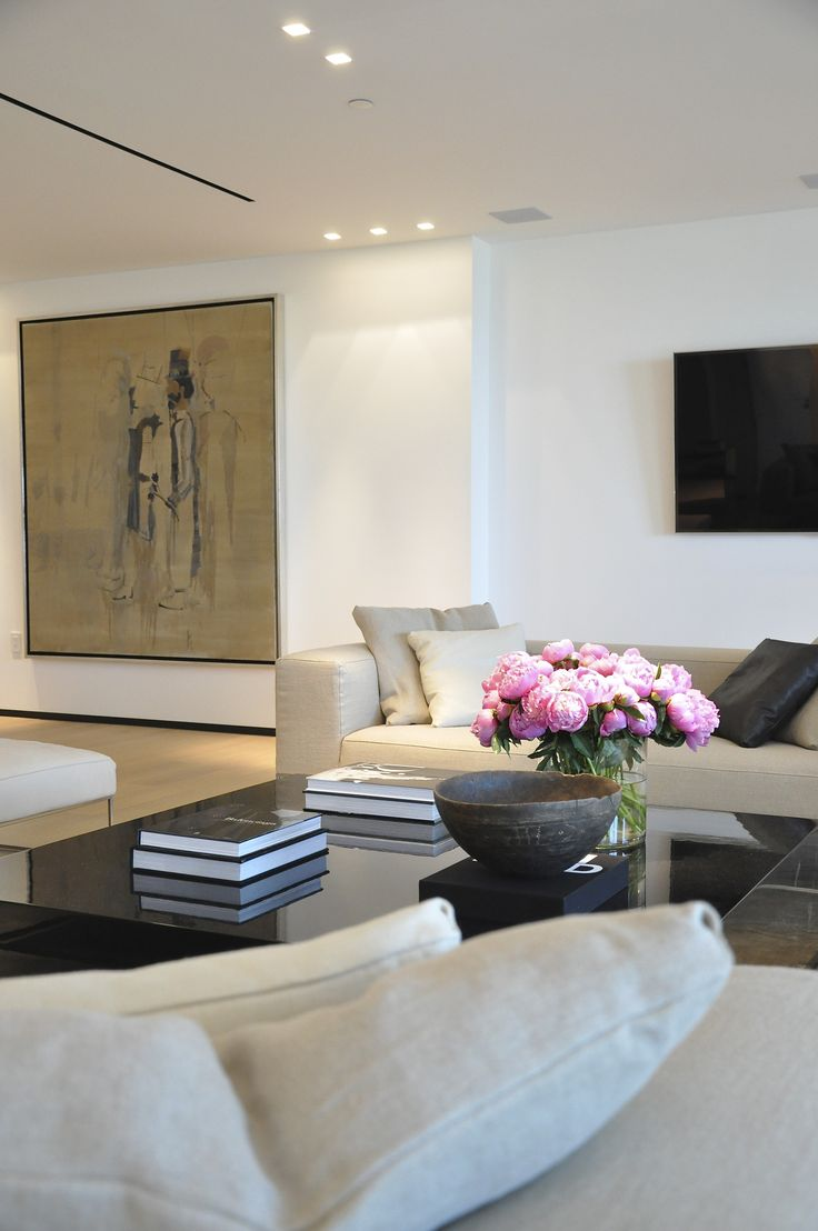 living room + pink peonies in a glass vase