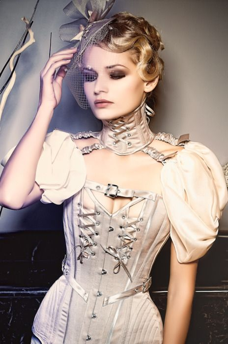 Cream steampunk. fascinator's are getting big again! wonder if girls will pick up some of the old hair styles again?