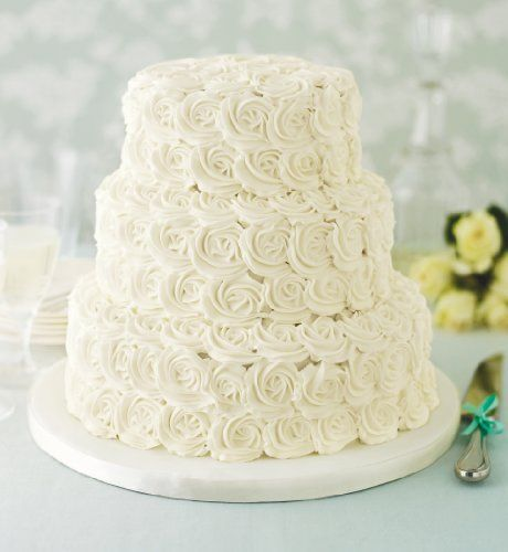 £249 marks and spencer! 3 tiers - bottom = fruit  Middle = chocolate  Top = sponge    Always wanted a combo wedding cake!!!