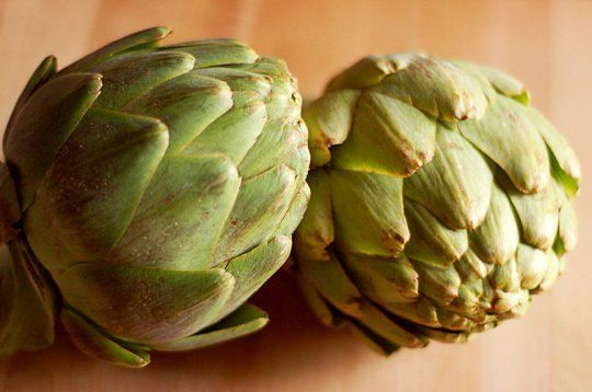 Buy artichokes that feel heavy for their size and with tightly compressed leaves. Smaller artichokes will likely be more sweet and tender th...