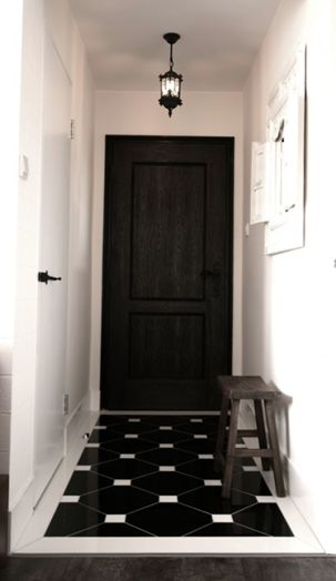 Black and white hallway at entry. Love the black door.