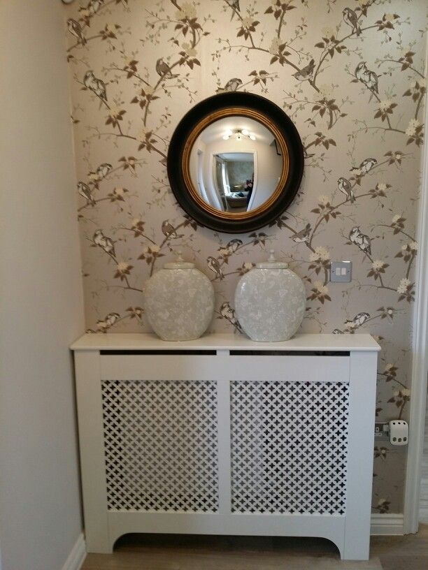 Taylor Wimpey Interiors - Wychbold.  Chivasso Botanicals Avarium silver Bird wallpaper - modern chinoiserie style for the hallway idea. Eau de nil Chinese ginger jars and jali radiator covers - the hall paint colour opposite was elephant's breath grey which looked stunning.