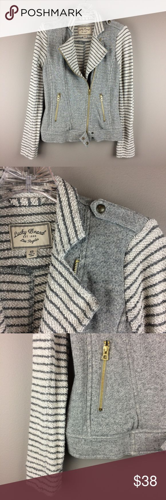 Lucky Brand gray stripe zip up moto sweater jacket Condition: Preowned, no holes or stains. Great condition.  Color: shades or gray and off white  Measurements: Size XS Underarm to underarm is approximately 16 1/2 inches across.  Length from back of neck to bottom of hem is approximately 22 1/2 inches. Sleeve length from top of shoulder at seam is approximately 25 inches.   Materials: see photo of tag Lucky Brand Jackets & Coats