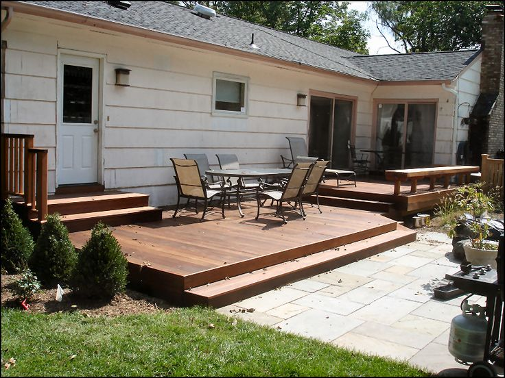 Low Deck to existing patio with stairs from door Den