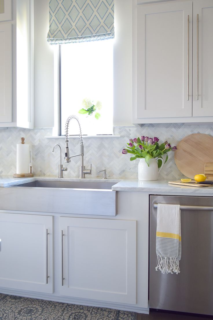 design decision gone wrong / white carrara marble herringbone backsplash / white kitchen /