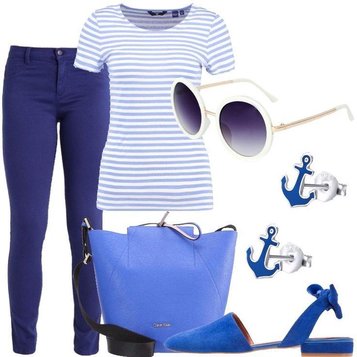 I pantaloni a vestibilità aderente sono blu scuro. La t-shirt in cotone e a mezze maniche è a righe orizzontali bianche e azzurre. La borsa a mano è in similpelle blu elettrico con la tracolla blu scuro e disegnata dallo stilista Calvin Klein. Le ballerine sono scamosciate, blu elettrico ed aperte dietro con un fiocco decorativo sul cinturino. Gli orecchini sono d'argento, a forma di ancora, smaltati di blu. Gli occhiali da sole, infine, un ...