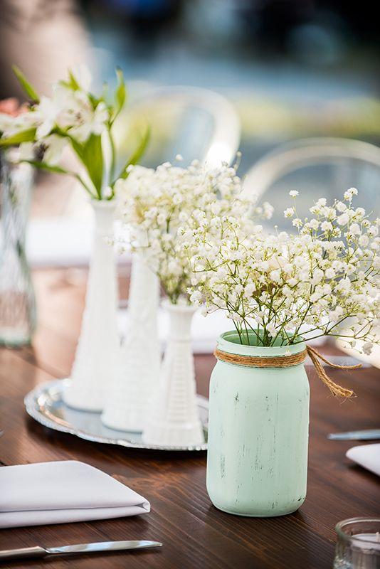 Vintage milk glass vases and painted Mason jar wedding decor