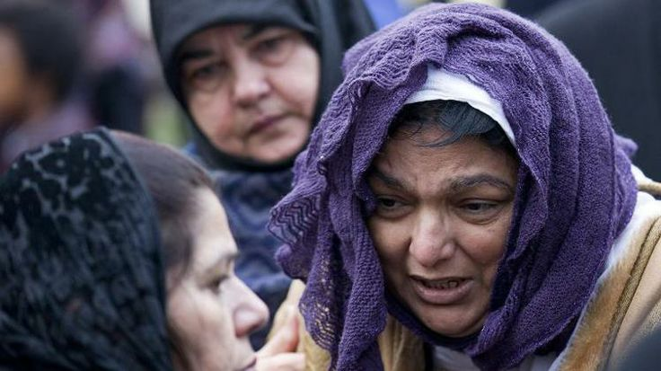 Fatima Khan (R), the mother of Abbas Khan, is comforted after prayers at Regent's Park Mosque in central London on December 26, 2013