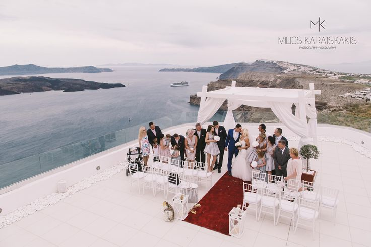 #weddingideas #weddingphotographer #perfect #photoshoot #red #capret #white #candles #after #wedding #decoration #unique #view #volcano #ship #ceremony #kiss #family #drone #photo #oia #mykonos #folegandros #santorini #Greece #miltoskaraiskakis