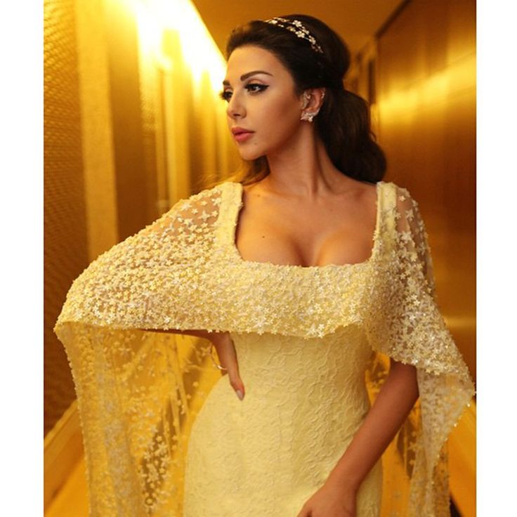 A Glamour High Note! The Queen Of Stage Myriam Fares Is Wearing A Tight Fitted Backless Rami Kadi Dress With A Hand Embroidered Cape