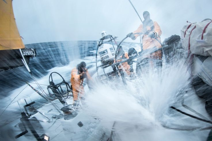March 29, 2015. Leg 5 to Itajai onboard Abu Dhabi Ocean Racing. Day 11. Daryl Wislang, Justin Slattery, and Ian Walker charge the Southern Ocean as another wave breaks overhead Matt Knighton / Abu Dhabi Ocean Racing / Volvo Ocean Race