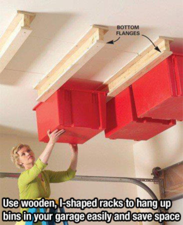 Great garage idea. Use wooden I-shaped racks to hang bins on the ceiling and save space