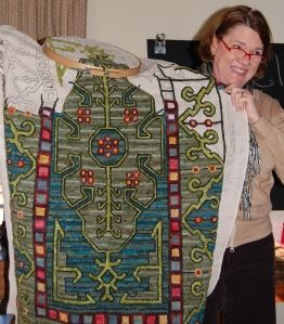 """""""Turkish Primitive"""" in progress. Pamela Brown Welch at a Foxy Lady Rug Hooking Guild meeting."""