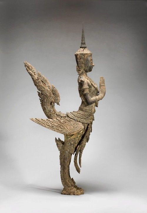 1775-1850. Kinnon – half bird-half man  inhabits an Eden-like forest of Buddhist legend and adorn Buddhist temples, at one time even lamposts, in Thailand. aka The mythical bird-man of Siam. carved wood