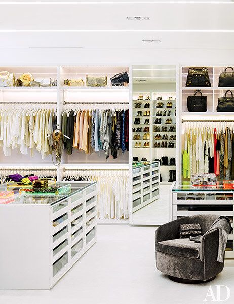 Alexandra Von Furstenberg's closet features lacquer cabinetry accented with glass, white leather, and chrome.