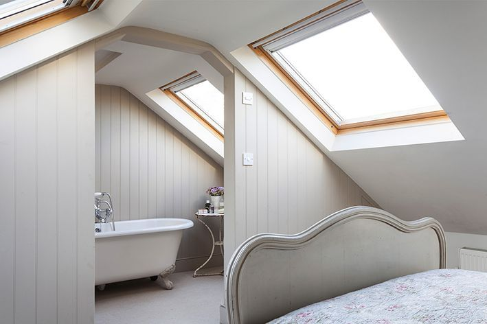 A roll-top claw foot bath sits at the other end of the attic bedroom...Full details on Modern Country Style blog: Swedish/French Style Victorian House Tour