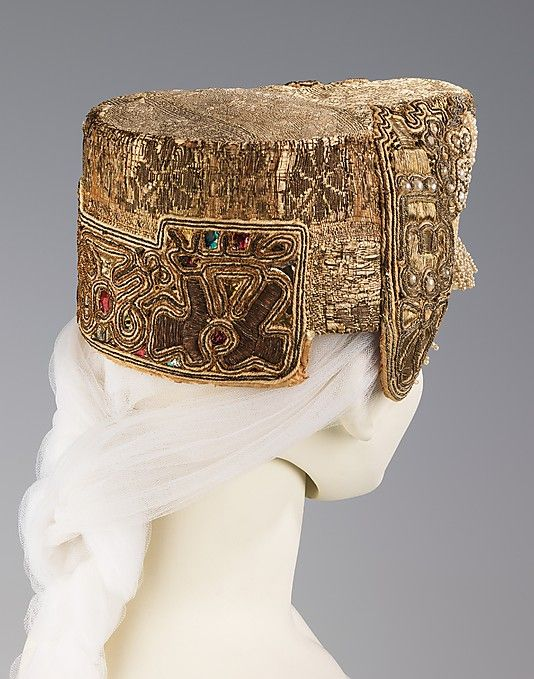 Headdress    Date:      early 19th century  Culture:      Russian  Medium:      metal, pearl, cotton, paper  Dimensions:      5 1/2 x 8 1/2 in. (14 x 21.6 cm)  Credit Line:      Brooklyn Museum Costume Collection at The Metropolitan Museum of Art, Gift of the Brooklyn Museum, 2009; Gift of Mrs. Edward S. Harkness in memory of her mother, Elizabeth Greenman Stillman, 1931  Accession Number:      2009.300.1715