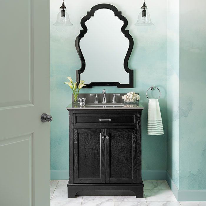 Convey a glamorous look in your half bath by pairing an elegant black allen + roth™ vanity with a marble countertop. Then add a polished-chrome faucet, a shiny towel ring, a shapely mirror, and sparkling clear-glass mini pendants. Mint-painted walls (Cucumber Chutney, #HGSW1296) feature a fashionable watery effect. The peel-and-stick luxury vinyl tile flooring is a stone lookalike that's easy to afford and install.