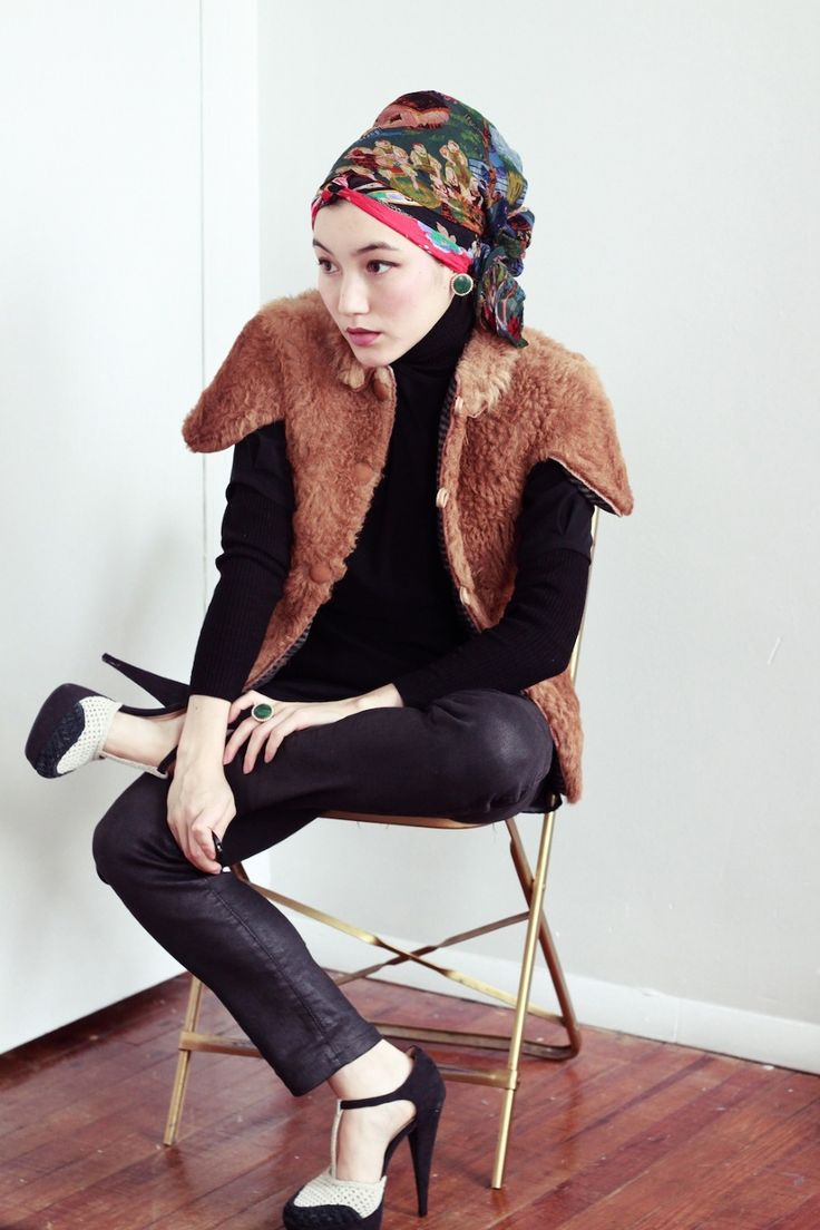 Fur vest, black pants, mary janes, and headwrap