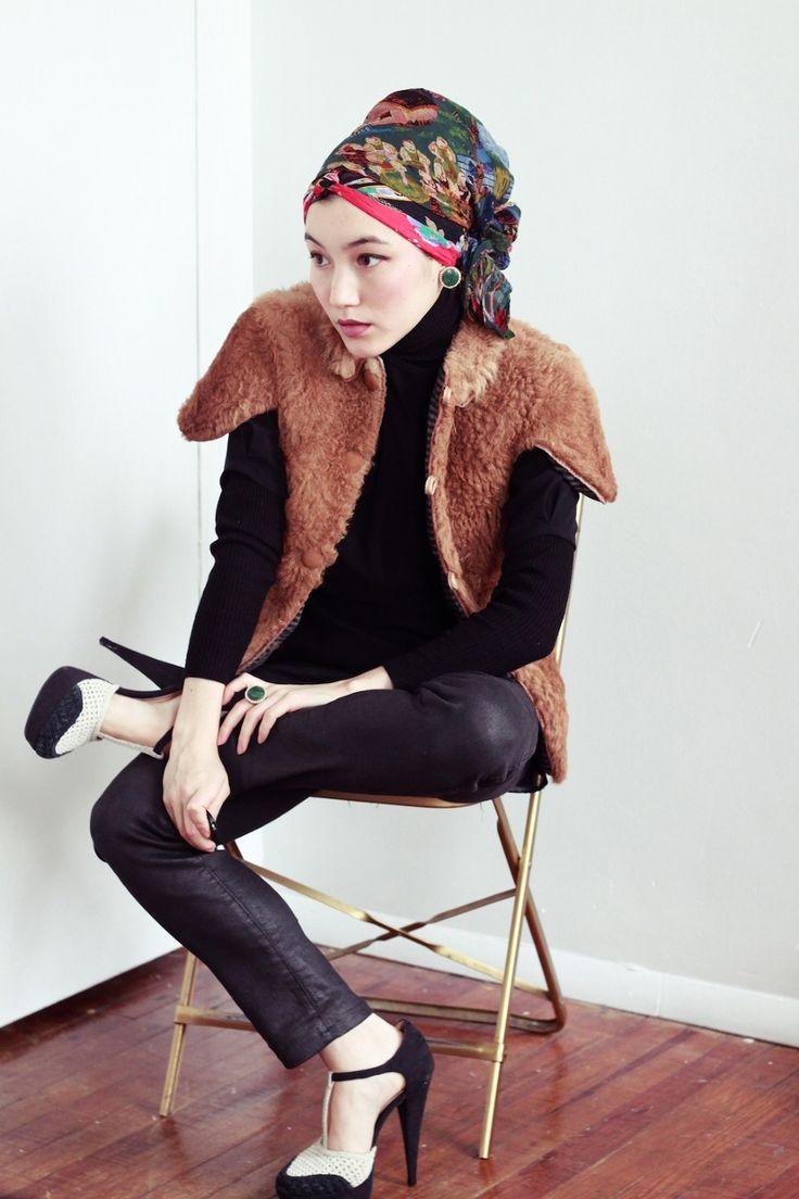 Fur vest, black pants, mary janes, and headwrap