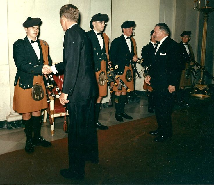(Left to right): Robert Fulton shaking hands with the President, Jerry Cashion and Tom Kirkpatrick; Drummer John Bosworth, behind Taoiseach Seán Lemass; and Sandy Jones (15 Oct., 1963)  The U.S. Air Force Pipe Band are wearing Irish uniforms borrowed for the occasion from the Co. Tyrone Pipers' Band of New York City.