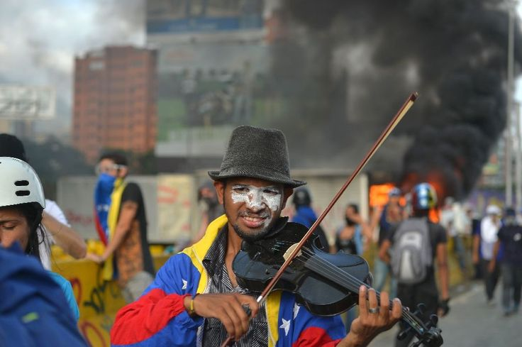 Amid #chaos, lone #street #violinist plays on...