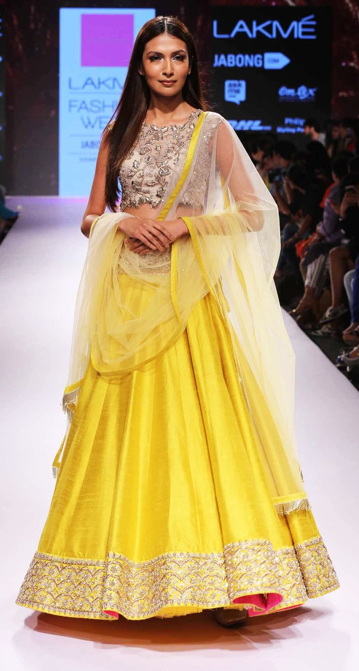 A beautiful shimmering yellow lehenga displayed at the LFW 2015 event.