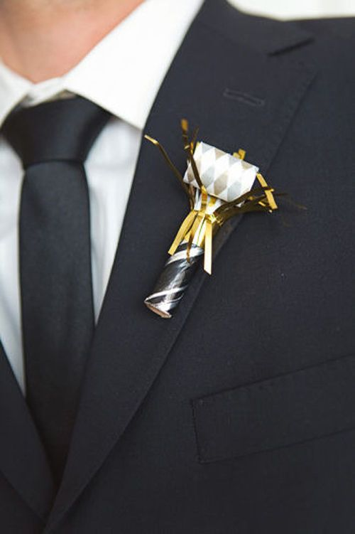 Noisemaker Boutonniere: Make sure your groomsmen are ready to cheer you and your new spouse down the aisle with this adorable noisemaker boutonnieres!