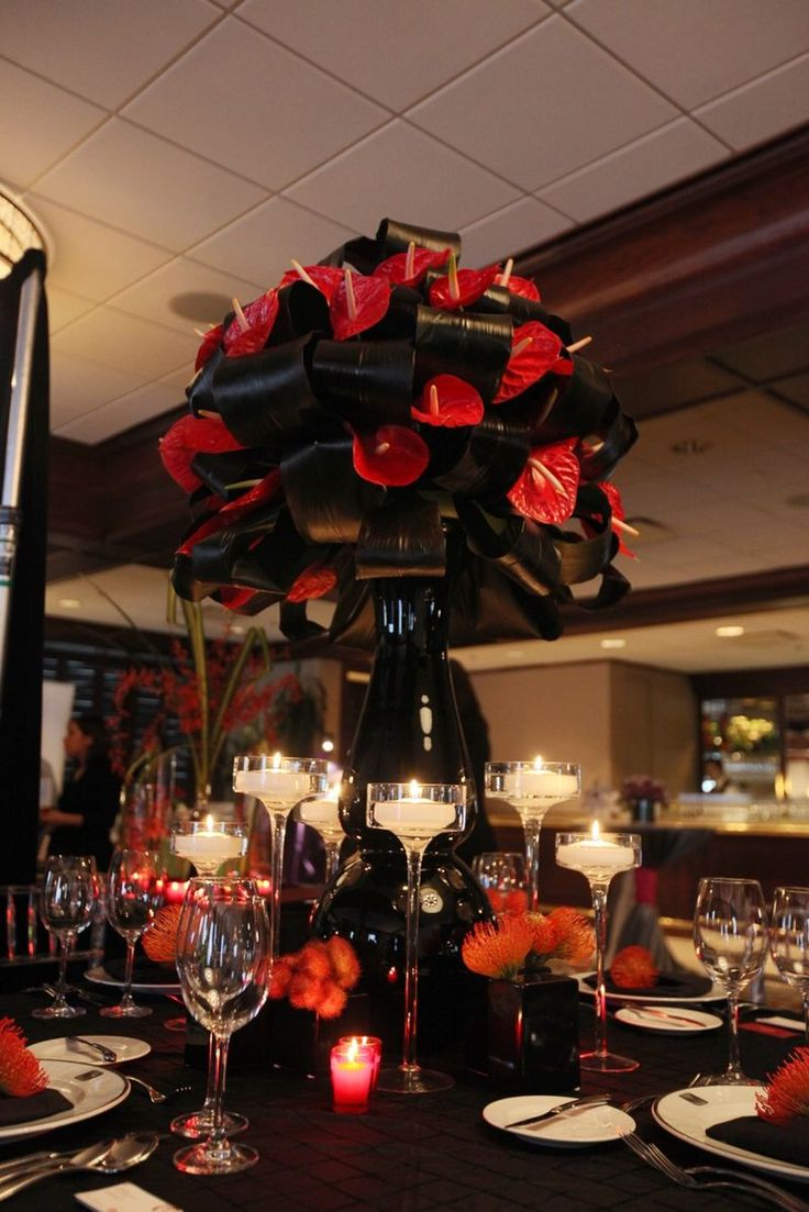 Centerpiece Floral: Red Anthurium, Black Ti Leaves, Red Pincushion Protea, and Red Lipstick Pods