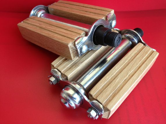 Wooden bicycle pedals - aesthetically pleasing, but impractical. The wooden bars provide essentially no grip, and this problem could be compounded by the fact that they don't look very wide. If you're not going to include some kind of friction tape or metal pegs/grips, you at least have to have a wide base.
