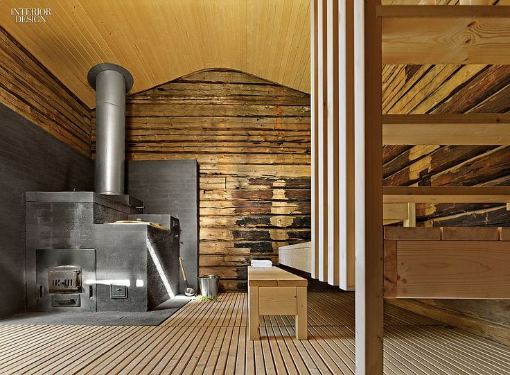 A House For All Seasons: A Retreat For Finnish Architect Anssi Lassila | In the property's separate sauna, a converted granary, 19th-century spruce-log walls contrast with new spruce. #design #interiordesign #interiordesignmagazine #architecture #sauna #wood #health