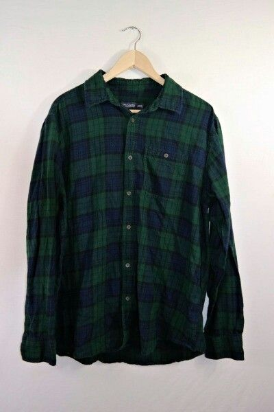 Oversized green and navy blue flannel. I would definately wear this with some leggings and some booties!