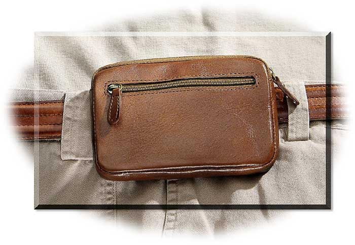 "$19.95 Small Leather Waist Pouch: The biggest problem with fanny packs and belt pouches is size. They are just too large! This small, unobtrusive pouch is just the right size for a small digital camera, a cell phone, your credit cards and cash or a small PDA. Measures only 3-1/2"" x 5-1/8"". Has a zipper pocket on the front and the top opens to a double compartment to handle both a camera and your cash and cards. The belt loop on the back will fit up to a 1-1/2"" belt."