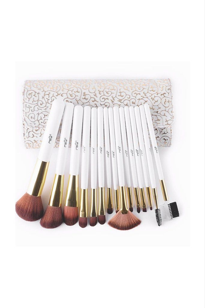 A set of fifteen synthetic, cruelty-free brushes in an ornate white PU leather bag. - Includes: 15 brushes, 1 bag Brush Material: Synthetic hair Handle Material: Wood Brush Tube: Aluminum Size: 12-18