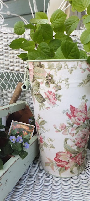 I Mod Podged fabric onto a metal flower bucket.  I will use it on my porch to hold gladiolas and hollyhocks.