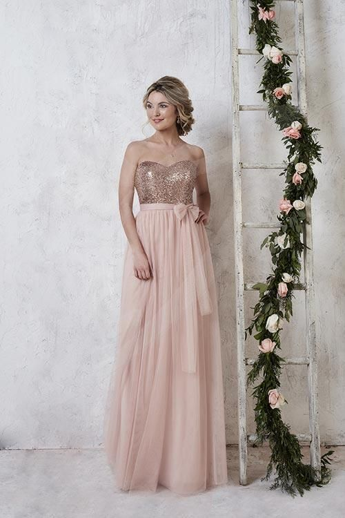 Balletts Bridal - 23447 - Bridesmaids by Jacquelin Bridals Canada - This elegant bridesmaid gown shows off a fully sequined bodice with a sweetheart neckline. Two long tulle straps attached at the waist act as an overlay to the sequin bodice, with endless options for tying. Complete with a long, flowing tulle skirt.