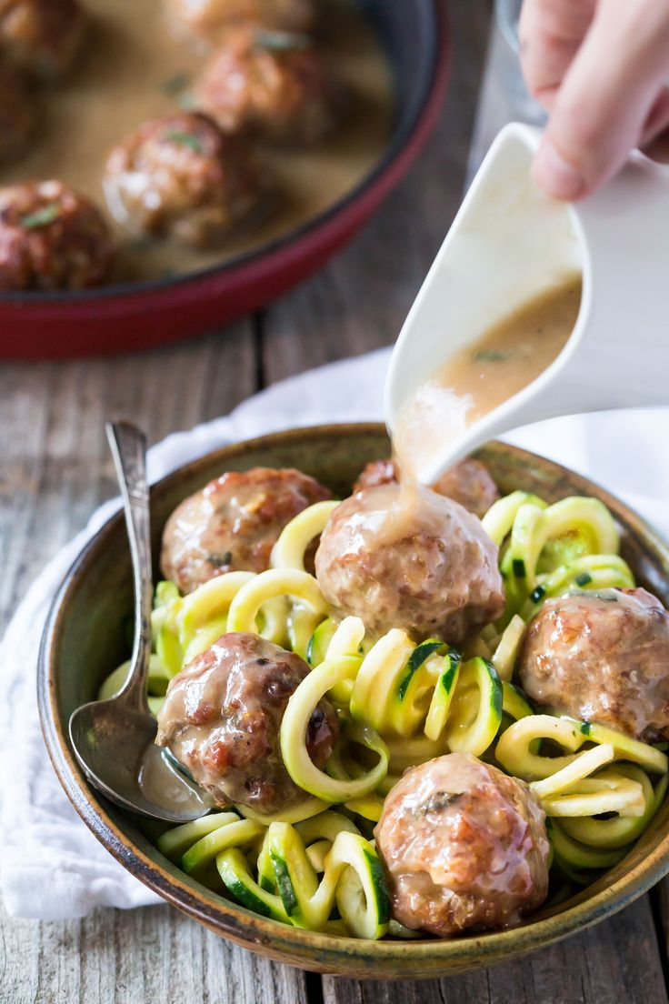Easy Whole 30 sage and onion Paleo Meatballs recipe with Creamy Dairy Free Gravy made with coconut milk, served with zucchini noodles (zoodles)