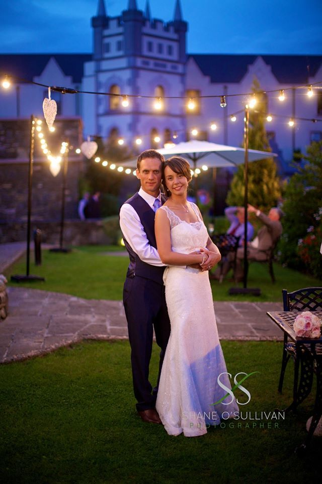 Embrace Couple with gorgeous lights behind him