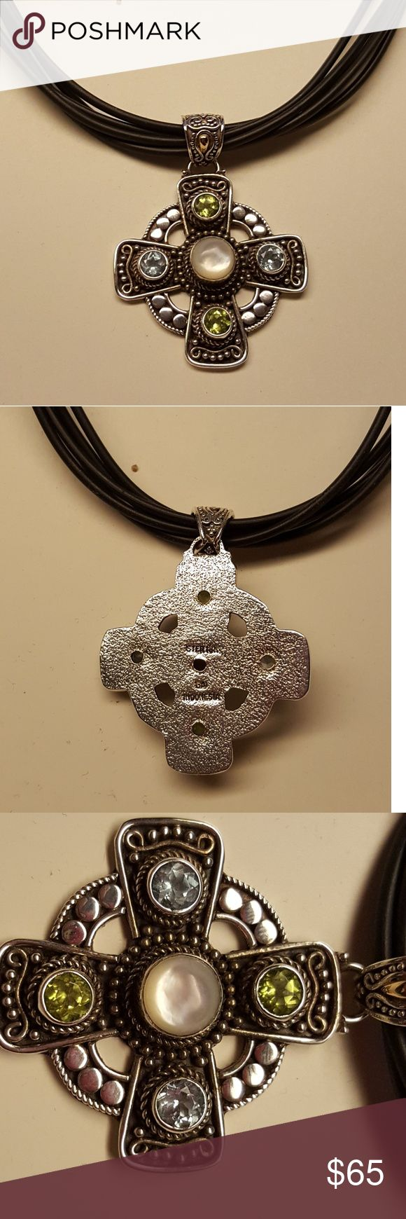 CELTIC CROSS W/LEATHER CORDS NECKLACE This beautiful Celtic cross comes with a larger moon stone centerpiece with 2 moonstone side stones and 2 praseolite side Stones  This pendant stands for strength. Leather cord included with 4 inch extender. QVC Jewelry Necklaces